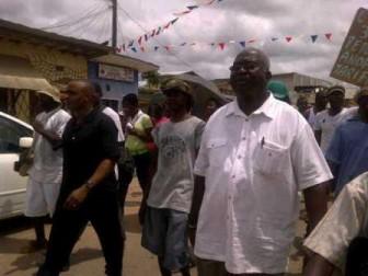 PPP/C supporter Denis Muhammed (in black) walking alongside former Regional Chairman Mortimer Mingo today.