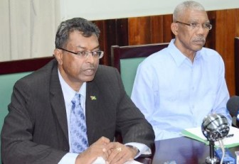 Leader of the Opposition and APNU David Granger (right) at a press conference today at Parliament with the AFC's Khemraj Ramjattan