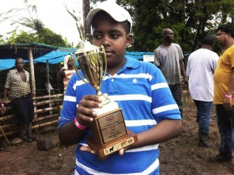 Shemar Pringle and his trophy (Jamaica Gleaner photo)