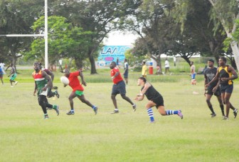 Players from the national 15's rugby team fine-tuning critical areas during their practice session  yesterday at the National Park ahead of their must-win game against Trinidad and Tobago on June 2 at the Providence National Stadium. (Orlando Charles photo)