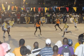 Action during Sunday night's Guinness Greatest of the Streets Exhibition Competition at the new Albouystown Basketball Court. (Orlando Charles photo)