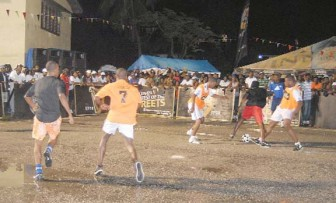 Guinness   Greatest:  Action during Wednesday night's Guinness Greatest of the Streets Exhibition game between Team Guyana (Back Circle) (wearing white) and the Island All Stars at the East Ruimveldt Basketball Court. (Orlando Charles photo)