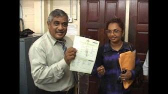 Khurshid Sattaur (left) handing over the first certificate (GRA photo)