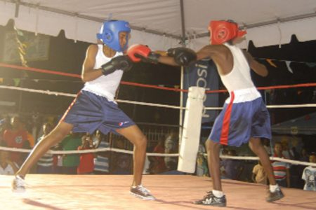 Shaka Moore, right of the Essequibo Boxing Gym, in action against Stephan Baldeo of Rose Hall Jammers Saturday night at the National Gymnasium tarmac.