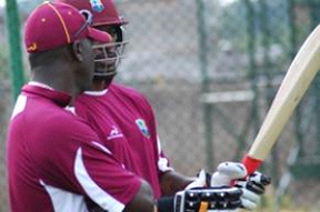 BACK TOGETHER AGAIN: Coach Ottis Gibson (left) chats with Chris Gayle last year.
