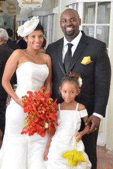 PJ Harding, son of Patrick and Dr Faith Harding tied the knot yesterday with Dr Lisa Field Ridley in a small ceremony at the Pegasus Hotel. In photo the bride and groom pose with their flower girl. (Photo by Anjuli Persaud)