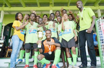 Boys' winners Lodge  Secondary, right and the girls' champion team North Georgetown.