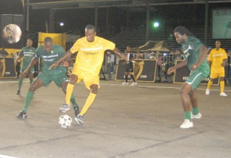 Action during last night's Back Circle Stallions' (Team Guyana) 2-nil victory over St Vincent in their third match of the three-night inaugural Guinness Caribbean Street Football Challenge  at the National Park tarmac.(Orlando Charles photo)