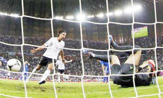 Germany's Sami Khedira (L) celebrates after scoring a goal past Greece's goalkeeper Michalis Sifakis during their Euro 2012 quarter-final soccer match at the PGE Arena in Gdansk yesterday. (Reuters photo)