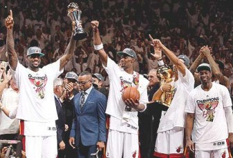WORLD CHAMPS! The Miami Heat celebrate their second NBA title with MVP LeBron James at extreme left.