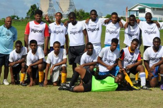 The Queen's College team with coach Johnny `Overseas' barnwell at left.