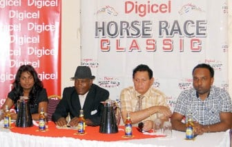 From right, Ramesh Roopchand, Digicel Advertising Manager, Justice Cecil Kennard - IMC Chairman for Horse Racing, Compton Sancho, Organiser and Darshnie Yusuf Public Relations representative of Ansa Mcal.