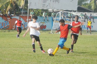 Action in the game between Queen's College and the Business School. (Orlando Charles photo)