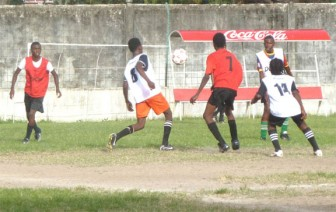 Action in the game between St George's and Houston Secondary yesterday at the GFC ground.