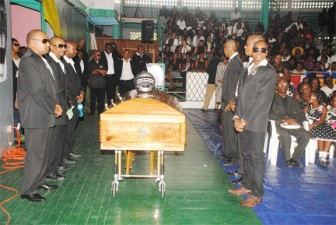 Family members, basketball players and others get ready to view the body of the late Damian Liverpool at the Cliff Anderson Sports Hall yesterday, a venue where Liverpool played some of his more memorable games as a member of the Ravens Basketball Club and also for Guyana. (Aubrey Crawford photo)