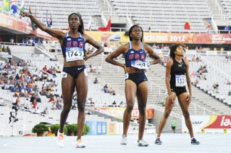 Guyana's Kadecia Baird, right looks up at the jumbotron to query her performance in the 400m at the World Junior Championships where she not only won a silver medal but clocked the `A' qualifying standard for the London Olympics.