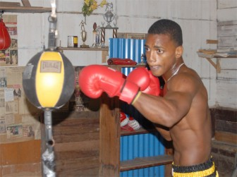 Kishawn Simon going through his paces during a workout yesterday at the Pocket Rocket Boxing gym. (Orlando Charles photo)