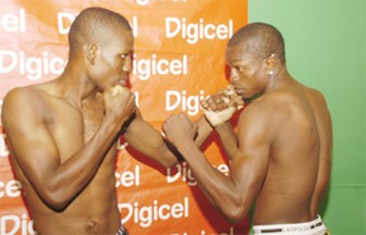 National featherweight champion Clive 'Wonder Kid' Atwell (left) and local lightweight title holder Revlon Lake square off for  Stabroek Sport  at the National Communications Network (NCN) studios yesterday. (Aubrey Crawford photo)