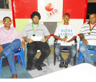 Sponsor of the Red Cherry chess tournament and former player Loris Nathoo, left along with Taffin Khan, Anthony Drayton and Kriskal Persaud following last Thursday's competition.