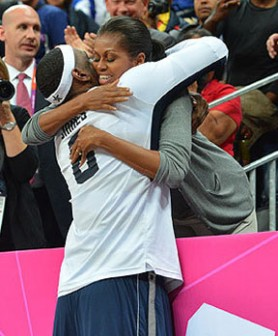 LeBron James gets a hug from United States of America First Lady Michelle Obama following the USA Dream Team's rout of France yesterday.