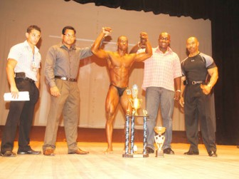 This year's Hugh Ross Classic Overall winner Kerwin Clarke is flanked by Hugh Ross and some main sponsors for Saturday night's event from left is CEO of Fitness Express Jamie McDonald, Reginald Persaud of International Pharmaceutical Agency and Clayton McKenzie, Brand Manager of Non Alcoholic Beverages of Banks DIH Limited. (Aubrey Crawford photo)