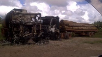 Two of the trucks that were burnt last evening