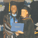 Zola (left) receiving her Bachelor of Arts Degree  in Education from the USM President Annalies Van Den Assem