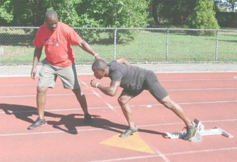 Jeremy Bascom and his coach preparing for today's 400m preliminary rounds at the London Olympic Games.