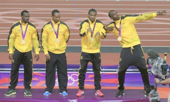 Jamaica's relay team, Nesta Carter, Michael Frater, Yohan Blake and Usain Bolt stand on the podium after receiving gold medals for the men's 4x100m relay at the victory ceremony at the London 2012 Olympic Games yesterday. REUTERS/JIM YOUNG