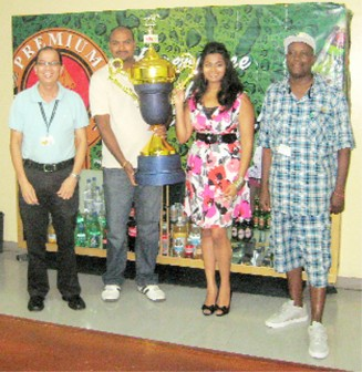 In the photo above, from left,  Brian Choo-Hen - Brand Manager - Banks/Premium Beer,  Gavin Jodhan, Branches Controller, Melissa Chattergoon, Guyana Cup Coordinator and Compton Sancho, deputy coordinator of the Guyana Cup with the main trophy.
