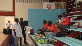 Guyana Table Tennis Association (GTTA) president Henry Greene and General Secretary Godfrey Munroe giving some members of the team a pep talk on Monday afternoon at the National Gymnasium prior to the team's departure for the 54th annual Caribbean championships in Santo Domingo yesterday morning. (photo courtesy of the GTTA)