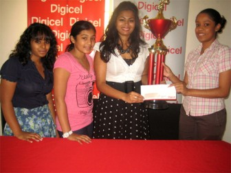Marketing Executive of Digicel (Guyana) Jayana Butts(extreme right) yesterday handed over a sponsorship cheque and a trophy on behalf of the telephone company to coordinator of the Guyana Cup, Melissa Chattergoon, and from left Amrita Dharamjit and Cindy Mohamed look on.
