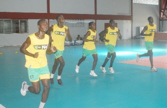 Some members of the Golden Jaguars team doing the beep test yesterday at the National Gymnasium. (Orlando Charles photo)