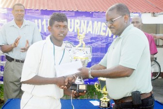 Transport's captain Joshua Ram receives the runners-up trophy from Brainstreet's Chief Executive Lance Hinds. (Orlando Charles photo)