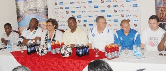 National Coach Golden Jaguars, Jamaal Shabazz (second from left) makes a point at yesterday's press conference as members of the head table which included sponsors,  El Salvador's team manager, Francisco Solis, El Salvador's captain Dennis Alas and president (ag.) of the Guyana Football Federation (GFF), Franklin Wilson look on. (Orlando Charles photo)