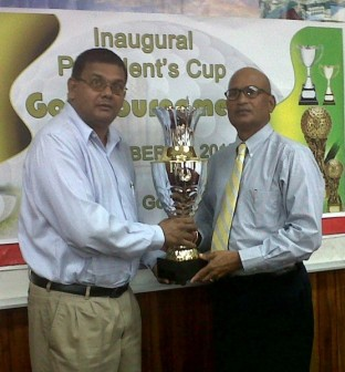Ministry of Tourism's Indranauth Haralsingh (left) and Lusignan Golf Club's president Jerome Khan display the President's Cup lien Trophy.