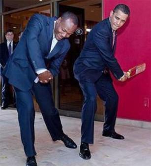Brian Lara seen above  giving US president Barack Obama batting lessons.
