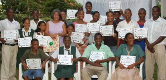 Gem Madhoo-Nascimento poses with some of the graduates on her Youth Theatre Workshop (Stabroek News file photo)