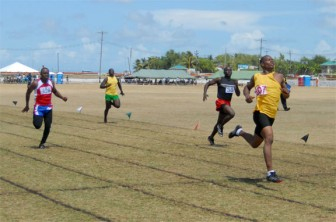 Quinse Clarke eases to victory in heat two of the Non Commissioned Officers 100m event in 10.9 seconds yesterday. (Orlando Charles photo)