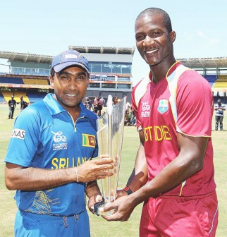 West Indies captain Darren Sammy and Sri Lanka skipper Mahela Jayawardene pose with the International Cricket Council's  Twenty20 World Cup trophy ahead of today's grand finale.