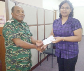 Lt. Col Terrence Stuart received the cheque from Rita Beharry, Marketing assistant at Sterling Products Ltd.