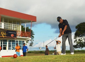 PERFECT FORM! Banks DIH Assistant Managing Director/Marketing Director George Mc Donald performs the symbolic tee off to get the Guyana Open golf tournament underway.