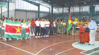 Prime Minister Samuel Hinds delivering the keynote address at yesterday's opening ceremony of the Goodwill games between Guyana and Suriname at the Cliff Anderson Sports Hall. (Orlando Charles photo)