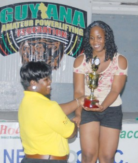 Kimberly Mars-Loncke, receiving her award from Dawn Barker at the completion of yesterday's Senior National Powerlifting Championships. (Orlando Charles photo)