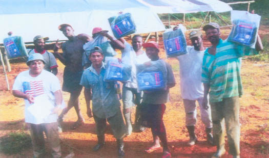 Miners in Region Seven display their treated mosquito nets