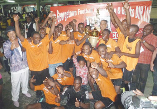 The victorious Sunburst Camptown Football Club team after the victory. (Orlando Charles photo)