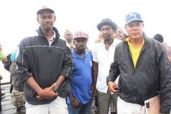 Clarence Belle (left) and other members of the Parika Speed Boat Owners Association.