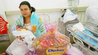 Stephanie DeGoeas cradles her baby boy at the New Amsterdam Hospital after receiving the Cheekies hamper