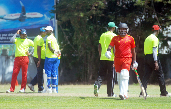 The President's XI players are glad to see the back of Gajanand Singh. (Orlando Charles photo)