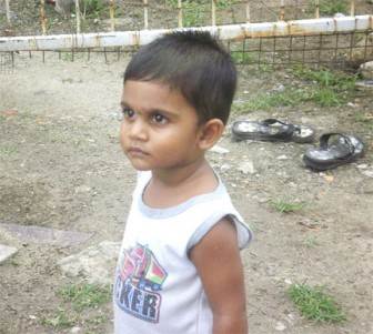 Little Aditya stares in the direction of the camera as his picture was taken